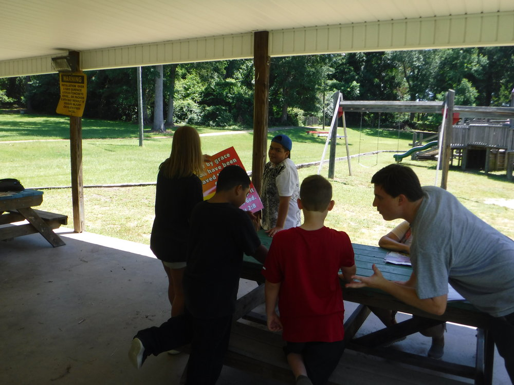 Games and group activities help children memorize and value Scripture.