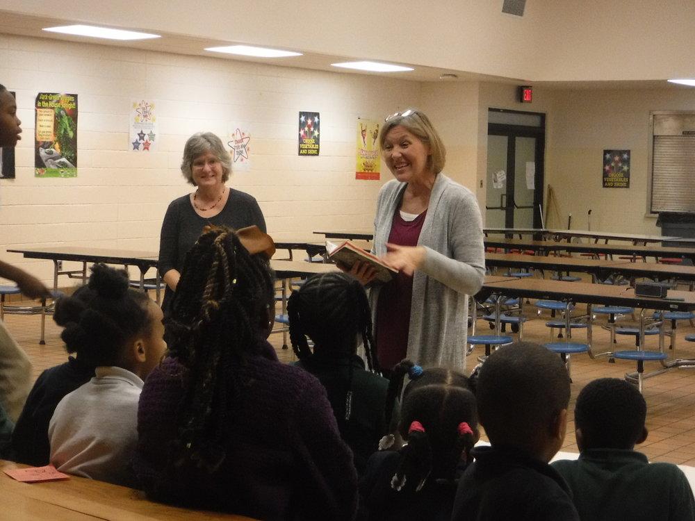 Karen Blake and Pam Jernigan from Grace Presbyterian teach children 1 Corinthians 15:3-4.