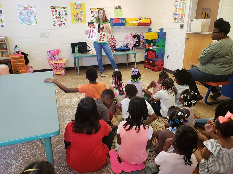 Kate Carver,  Christian Youth In Action ®  missionary, with Ruth Barnes, long time volunteer, teaches in a  5-Day Club®  at Bo Peep Day Care.