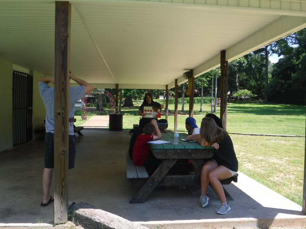 Abby Solomon and Mary Phyfer Parker,  Christian Youth In Action®  interns, with Jeremy Brown, student minister, and Cheryl Roberson, members of FBC Eclectic, host   5-Day Club® at Panther Palace Park in the center of town.
