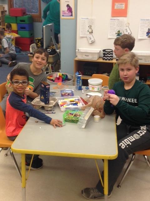 Making Leprechaun Traps with our buddies!