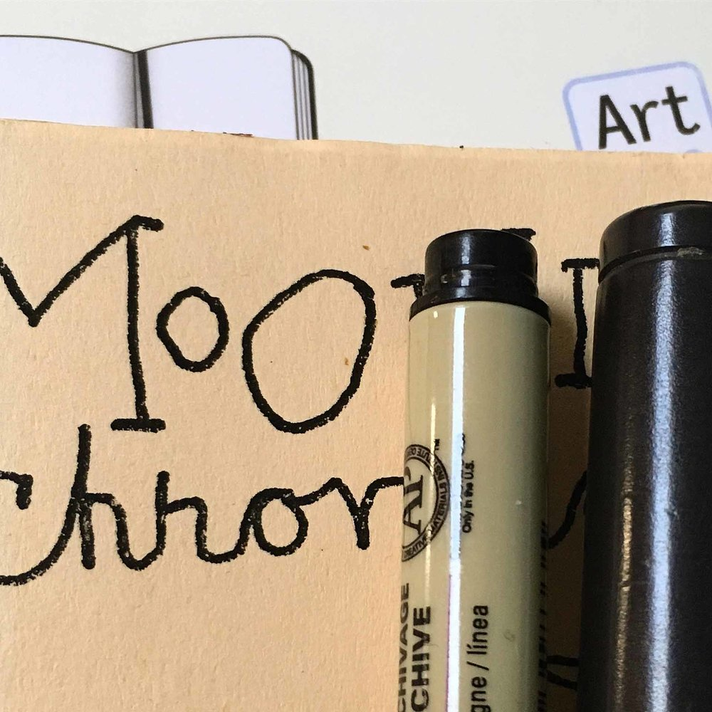 A Moonlight Chronicle and pens