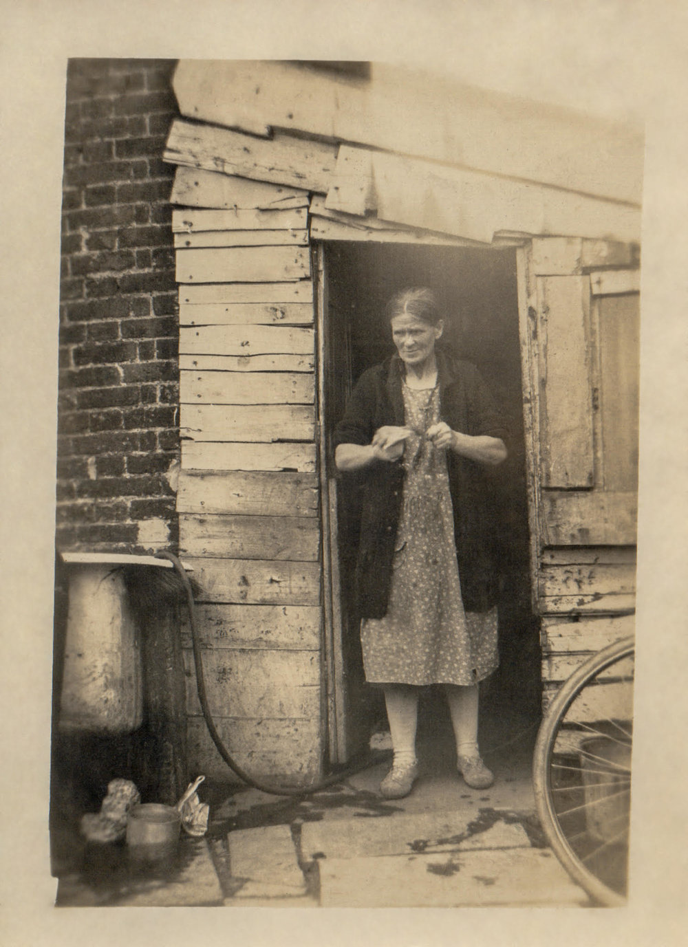 Ada Watts in the doorway of the boiler house where pigswill was prepared c 1935. Kindly reproduced by permission of Betty Jacobson nee Watts