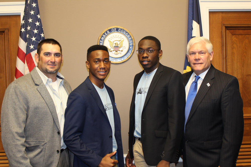 Wylie High School teacher, Chris Bogle, Andre Williams, Davis Okuzor and Congressman Pete Sessions during the Congressional App Challenge event.