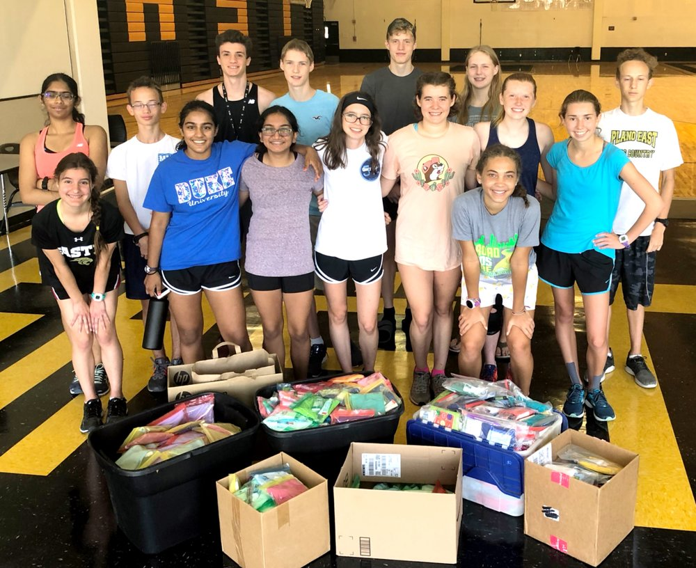 Plano East's cross country team helps pack supplies.