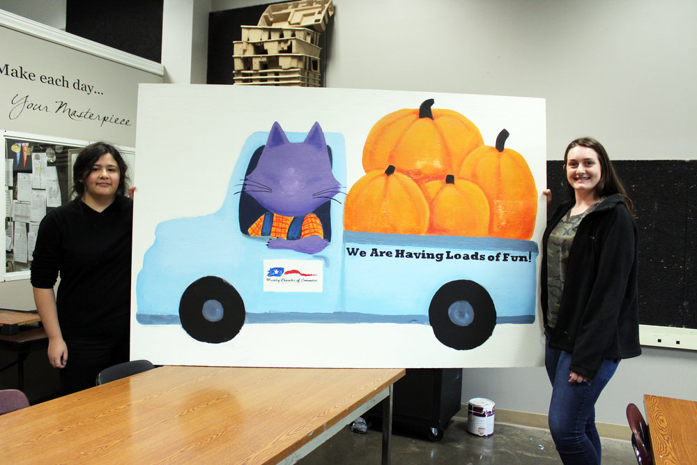Wylie High School students, (Left to right) Sabrina Wong and Christen Peterson, created artwork which will be used in a fundraising effort by the Murphy Chamber of Commerce Scholarship Foundation.