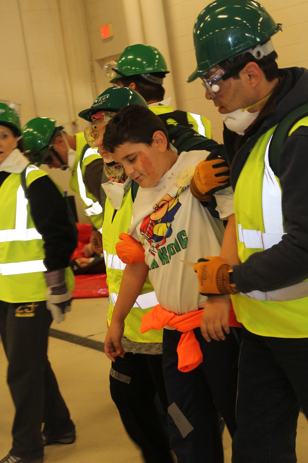 """Members of Boy Scouts from Troop 302 participated in CERT training as the """"victims""""."""