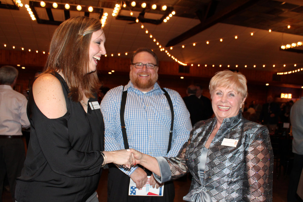 Murphy Mayor Pro Tem Jennifer Berthiaume and Ryan Sullentrup are greeted upon arrival by Donna Jenkins.