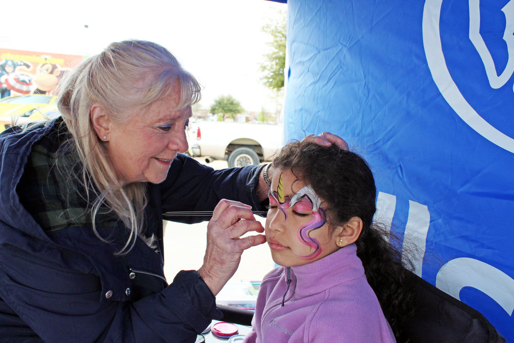 Murphy Allstate agent, Zane Shepherd, provided free face painting at his vendor booth. Minahil Mughal chose to have a colorful unicorn painted on her face.