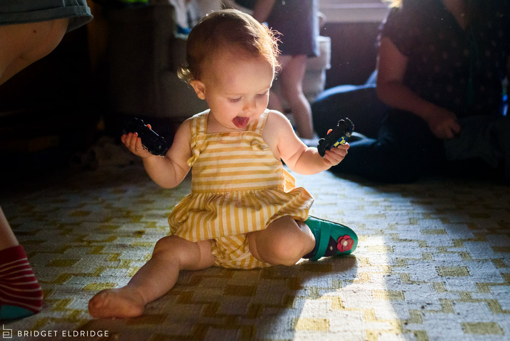 little girl plays in pretty light