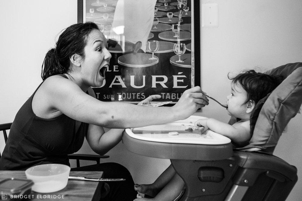 mom feeds baby breakfast