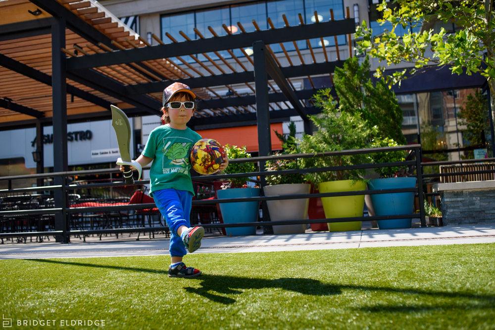 boy plays in courtyard at pentagon row