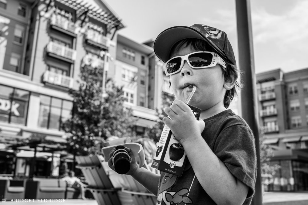 boy sips a milk and holds his sword at pentagon row