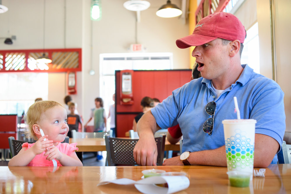dad and daughter wait for food at district taco in old town