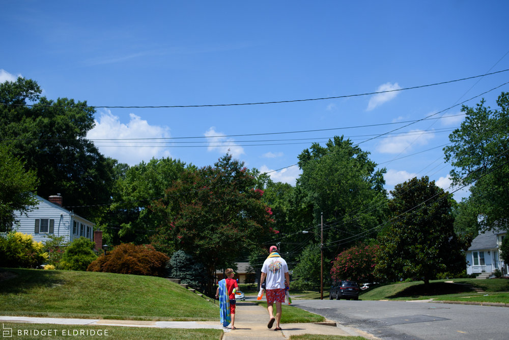 father and sun walk to the pool in the waynewood neighborhood in alexandria