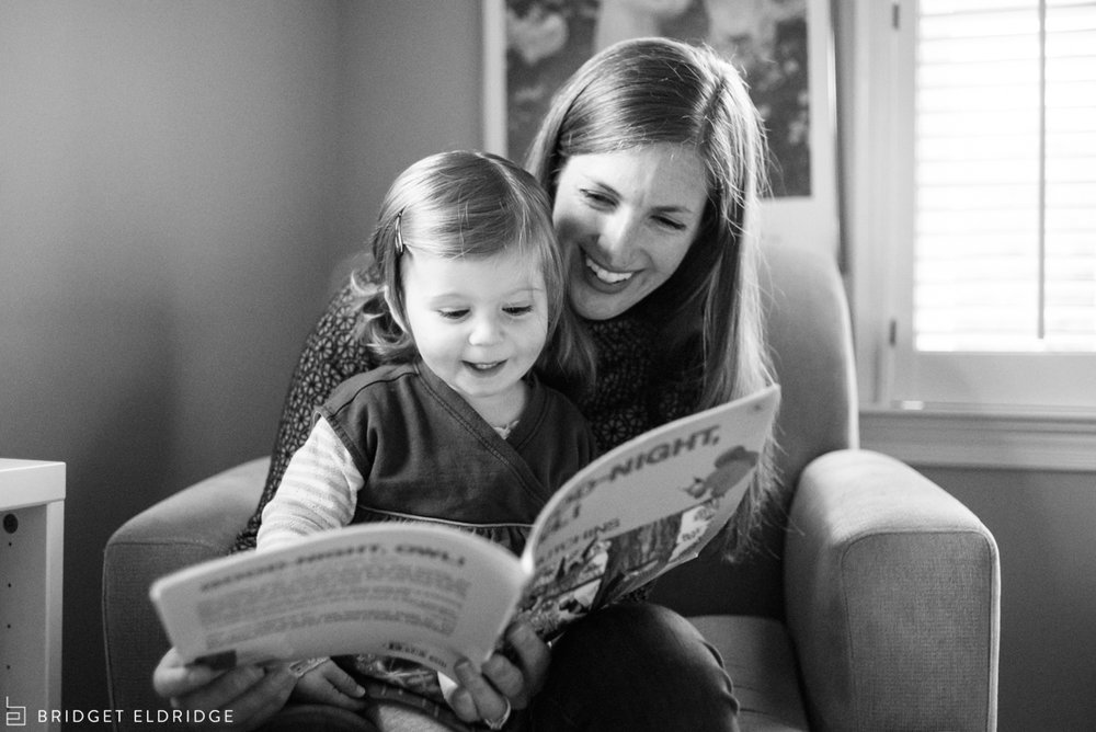mom reads to her daughter