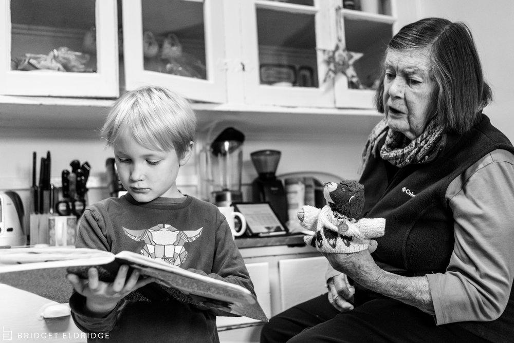 boy shows grandmother his homework