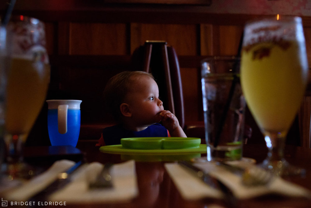 Toddler eats his lunch at Boxcar Tavern across the street from Eastern Market.