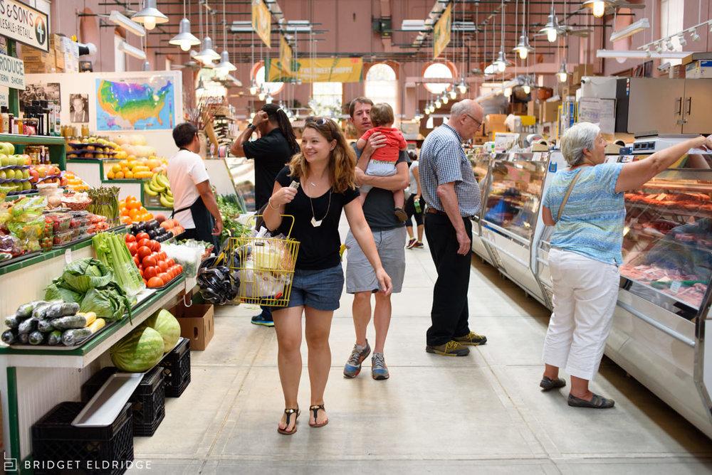 Family goes shopping for dinner in Eastern Market.