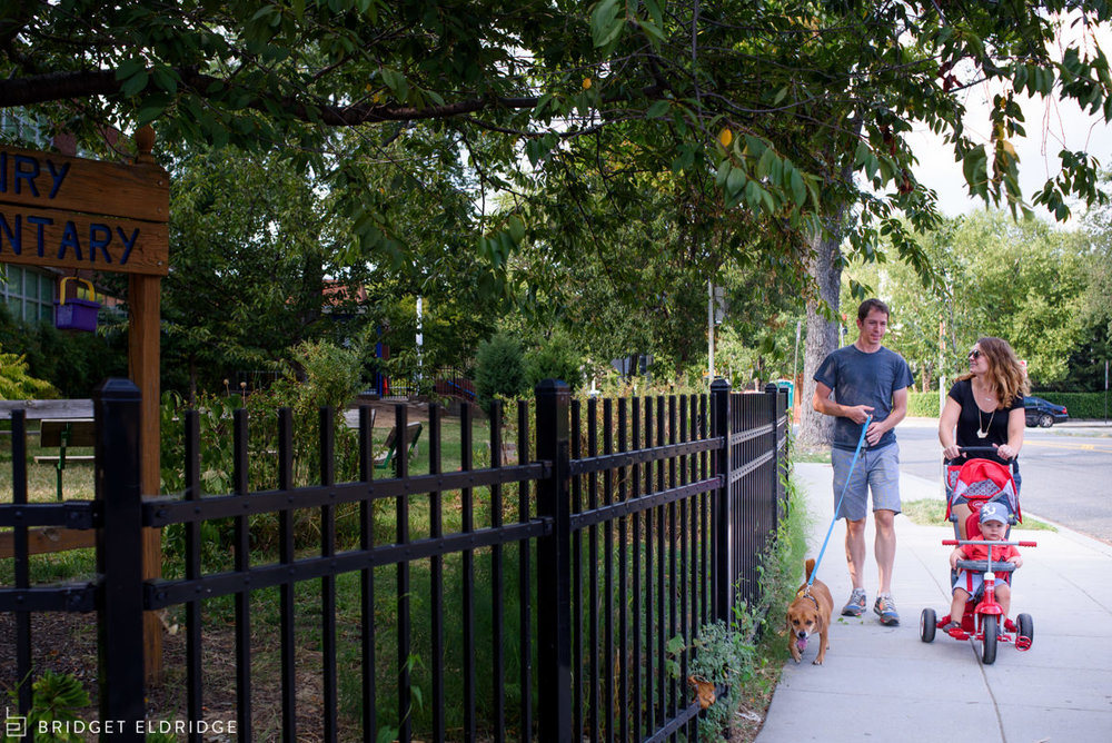 Family takes a walk in their Capitol Hill Neighborhood.