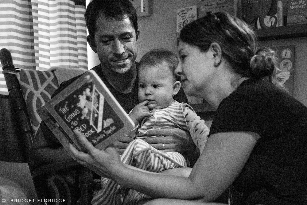 Mom and dad read their son The Going to Bed Book at storytime.
