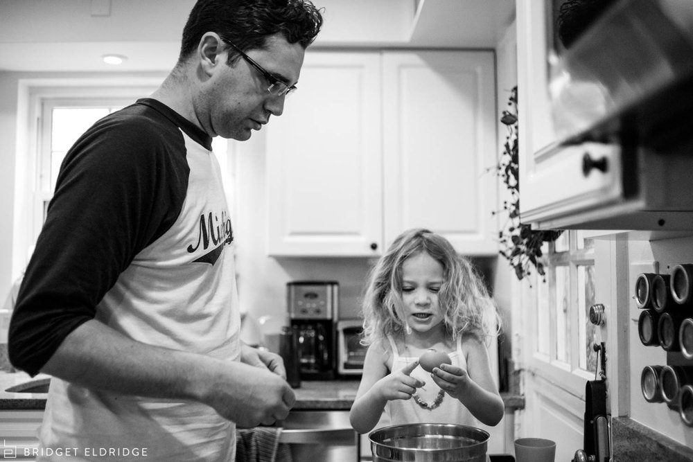 dad and daughter make mom breakfast for mother's day