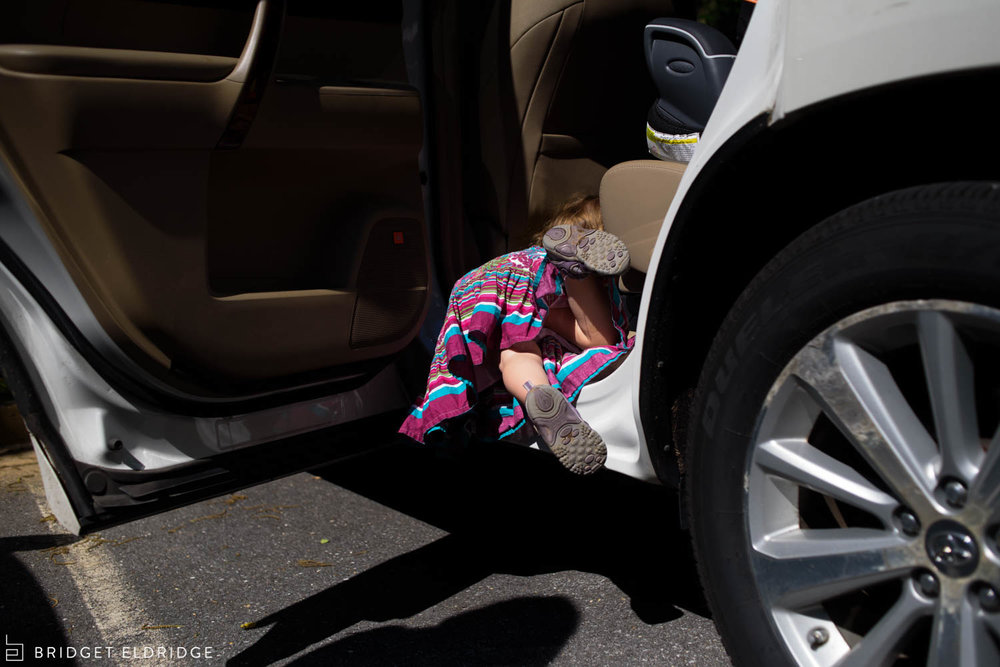 child climbs into her family car by herself