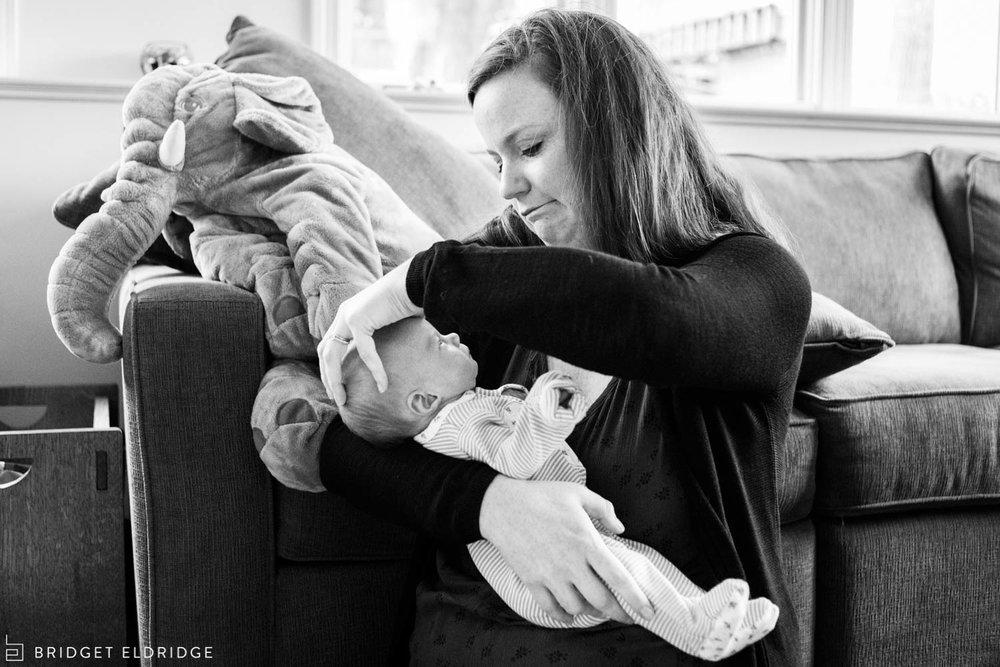 mom cleans newborn daughter's head