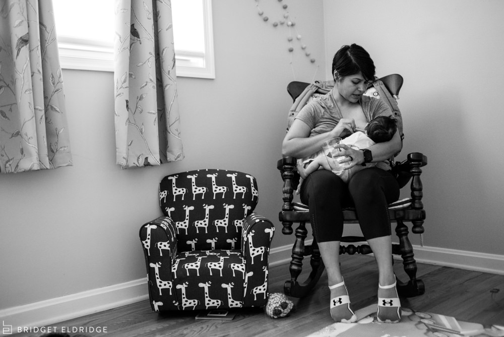 mom nurses her newborn daughter