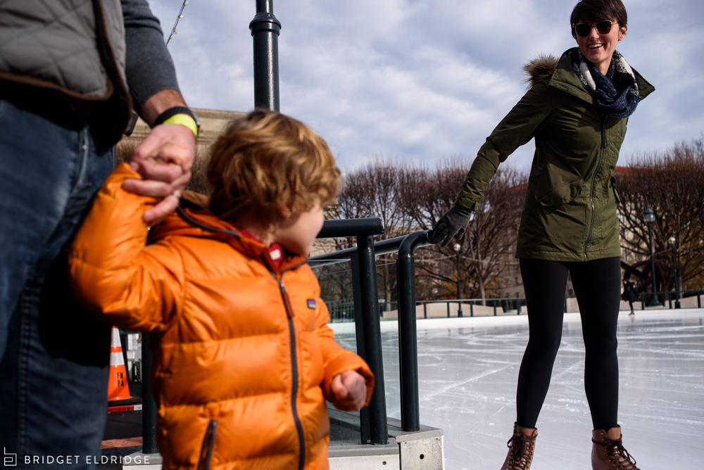 mom skates by and tells her family to get on the ice