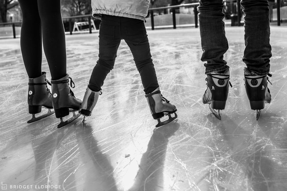 family ice skates together