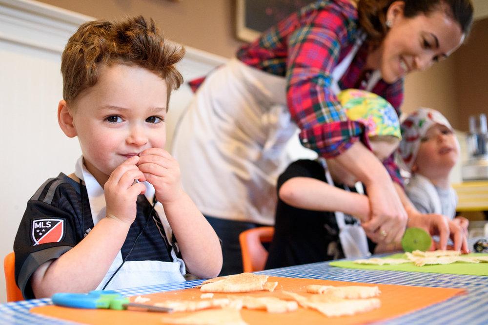 boy eats pita in cooking class