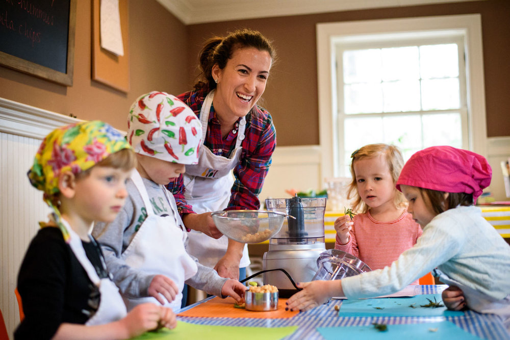 Chef Mari teaches kids about making hummus at Together We Cook