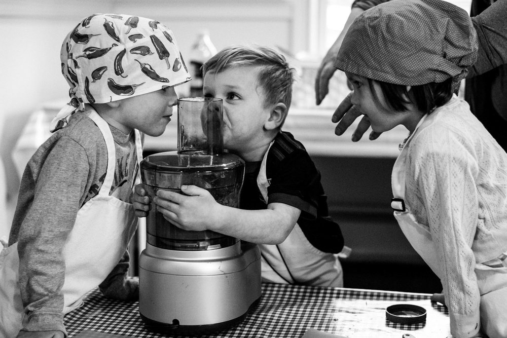 kids have a silly moment in cooking class