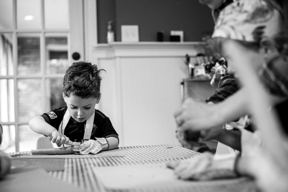 boy works on peeling a carrot