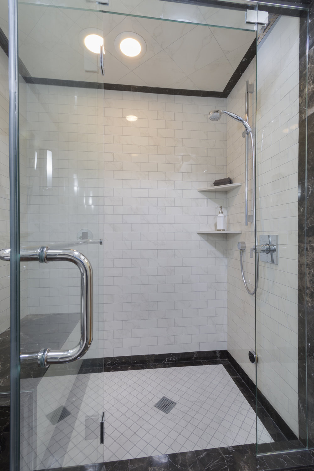 In the Master Bathroom, the tile pattern continues into the glass enclosed steam shower.