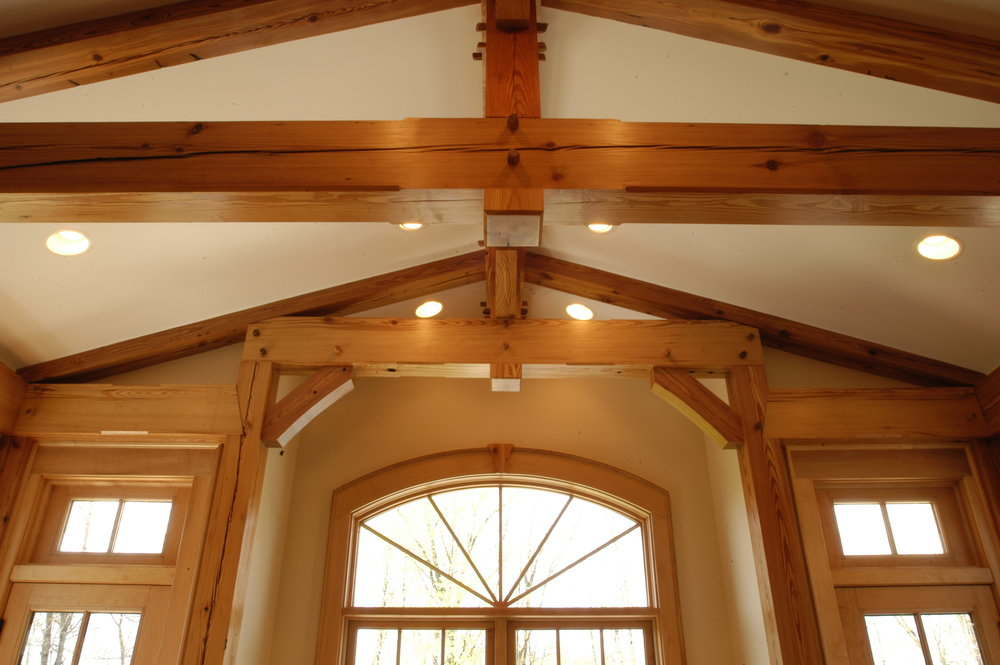 Detail of timber trusses at ceiling.
