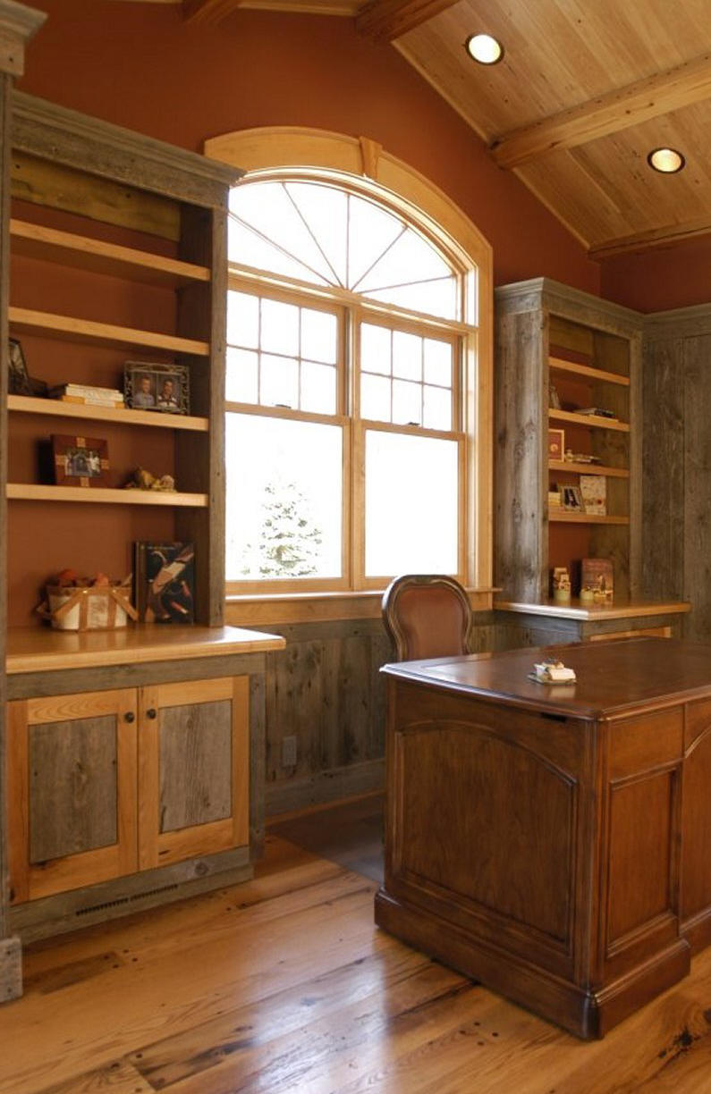 The wainscoting, cabinetry and shelving was made using recycled barn board.