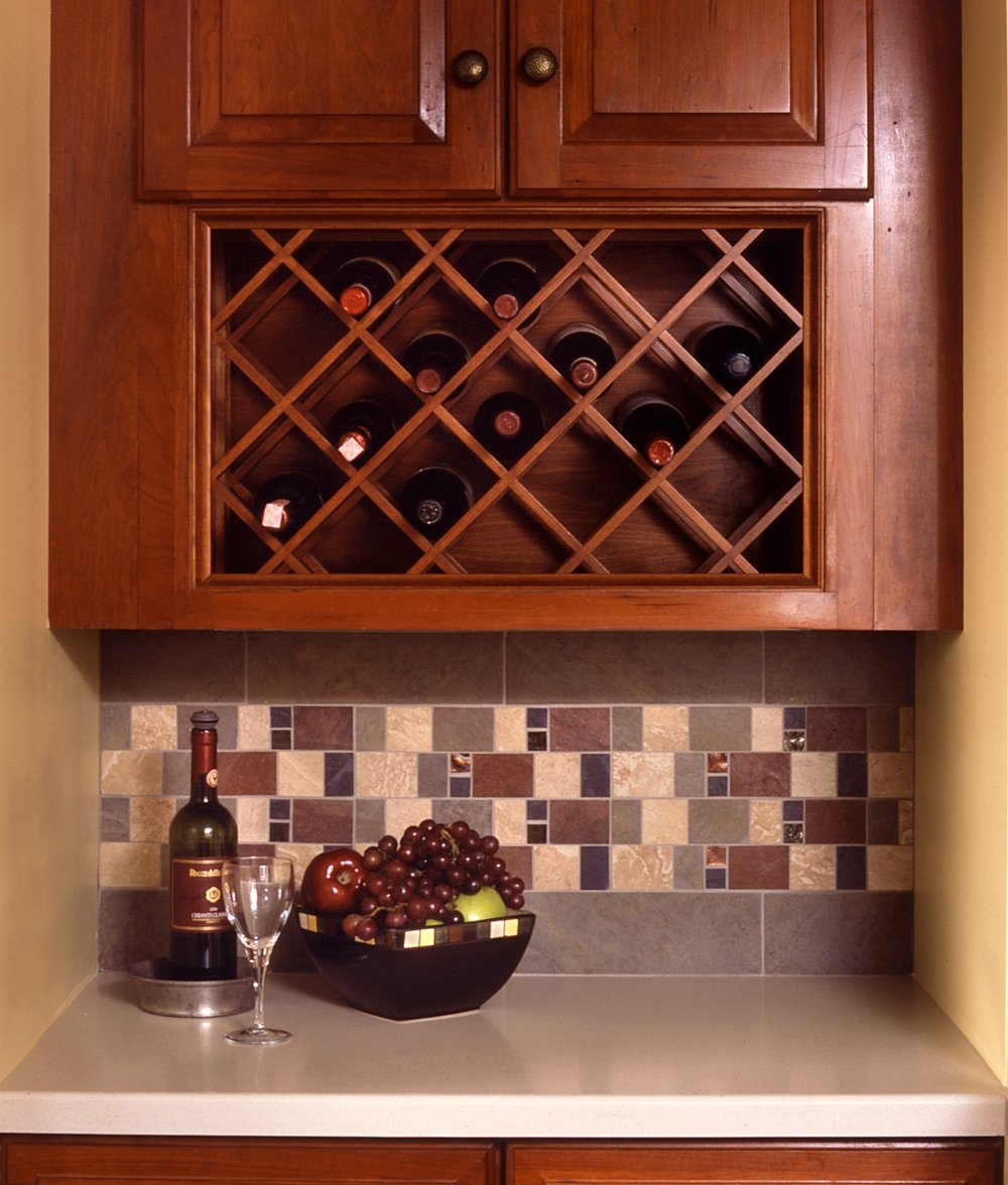 This corner of the Kitchen was formerly the doorway to the Back Hall and Sunroom. The wine rack in the upper cabinet was made from the former  microwave cabinetry.
