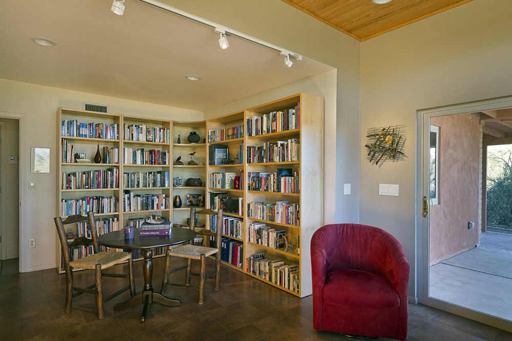 View looking back toward bookcases and the space of the former bedroom. The bookcases are from Copenhagen Imports, Inc. and the table is from Baker Dining Interiors, both of Tucson, AZ