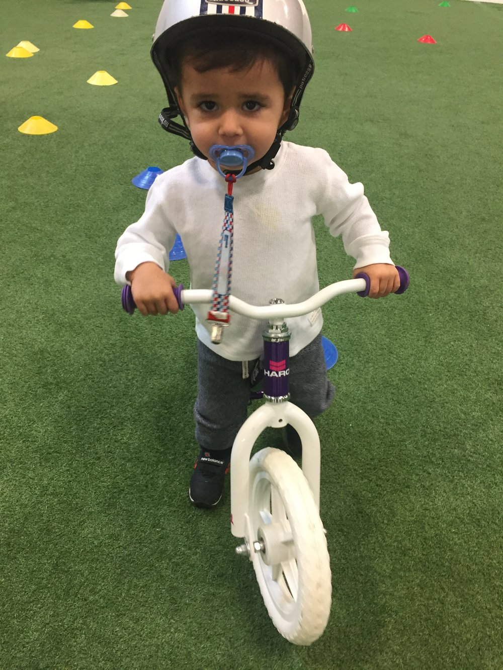 Itty Bitty on Bike with Pacifier.JPG