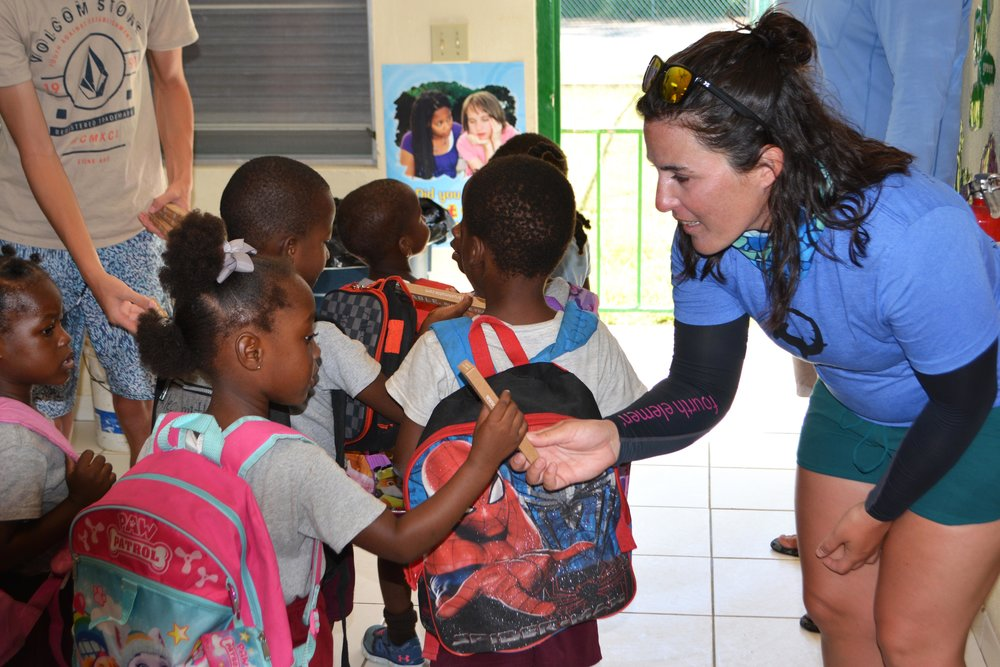 Guest Jenna offers local children a free    Mable    bamboo toothbrush