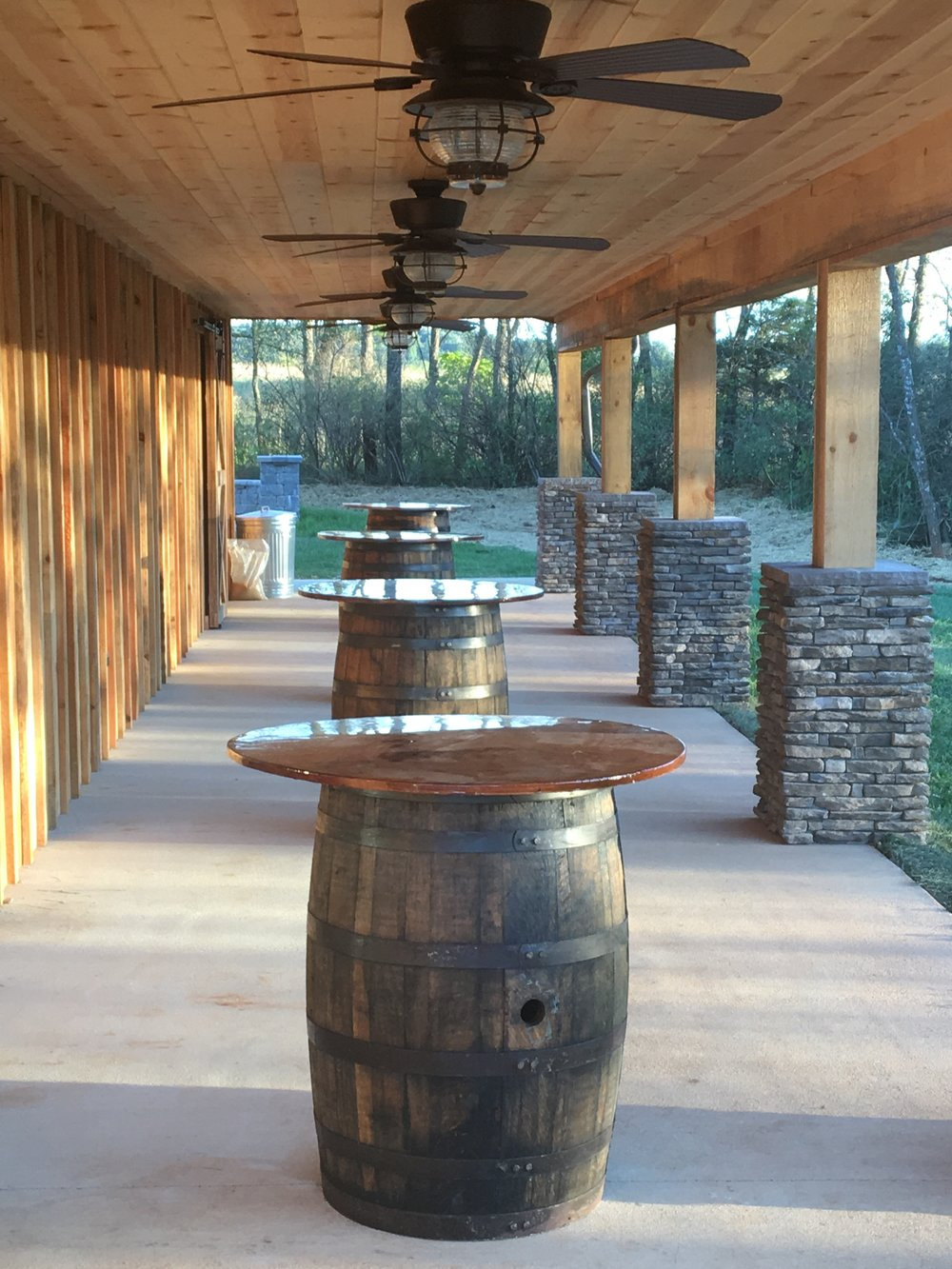 Covered patio area with barrels
