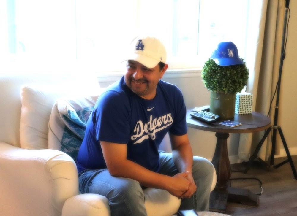 Michael in our living room, watching Dodger Opening Day.