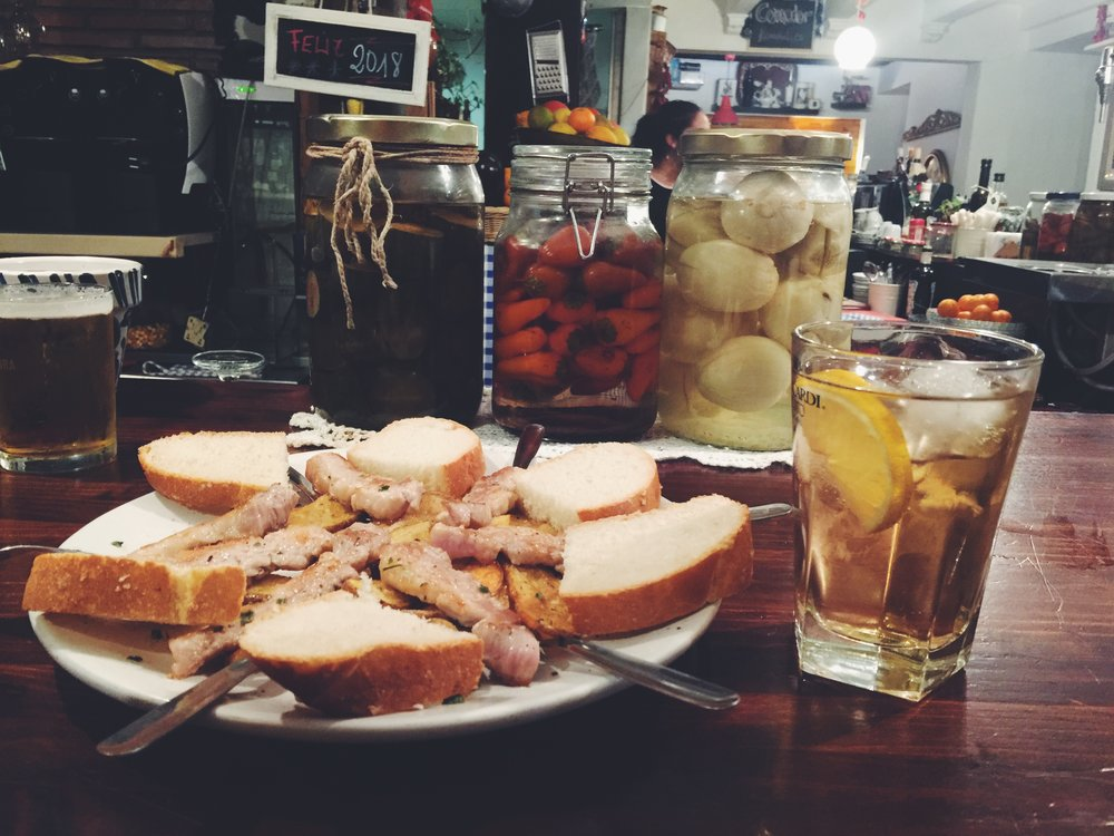 Fried pork served with fried potato and bread, and again my favorite drink - mosto on ice