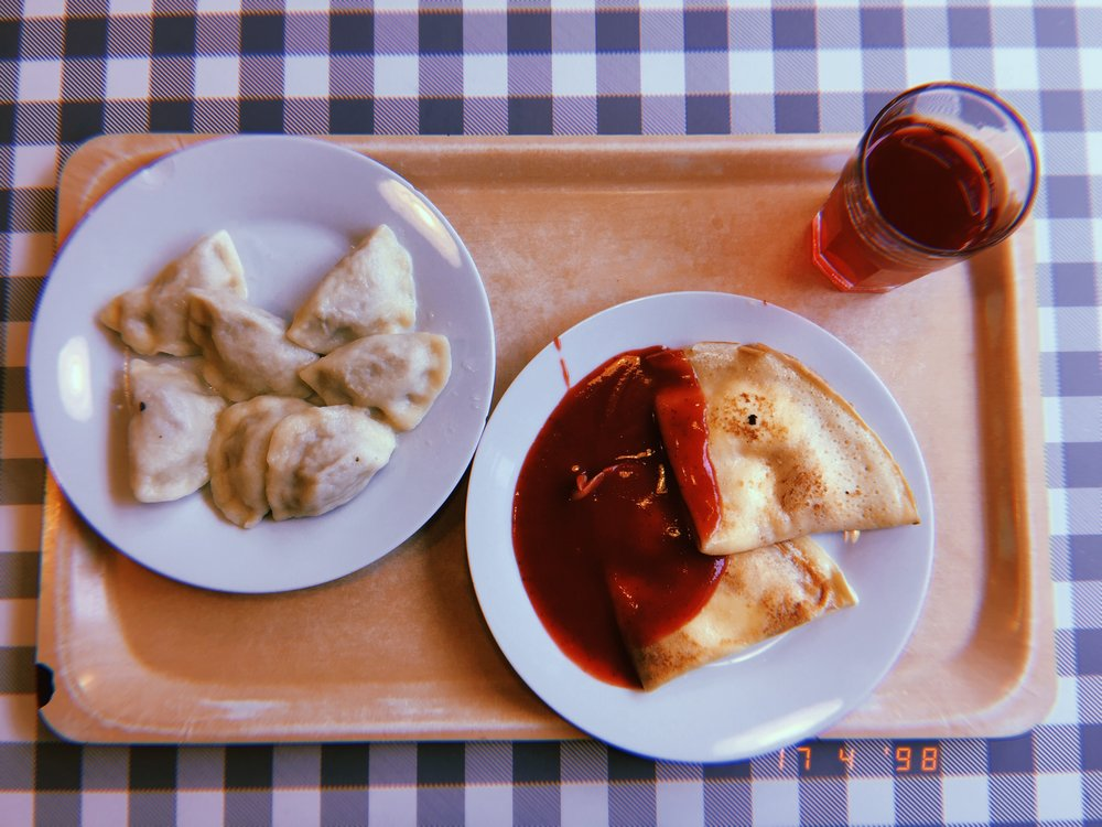 Pierogi, pancakes with soft cheese and strawberry sauce, and the so-so kompot drink