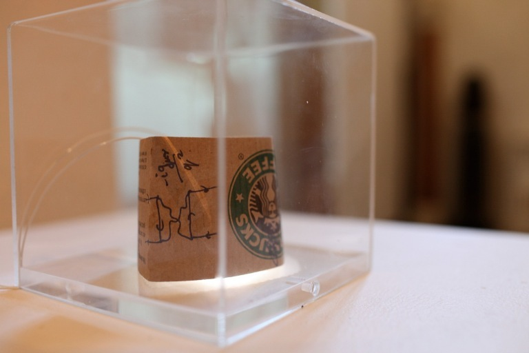Starbucks coffee cup holder with scientist's notation