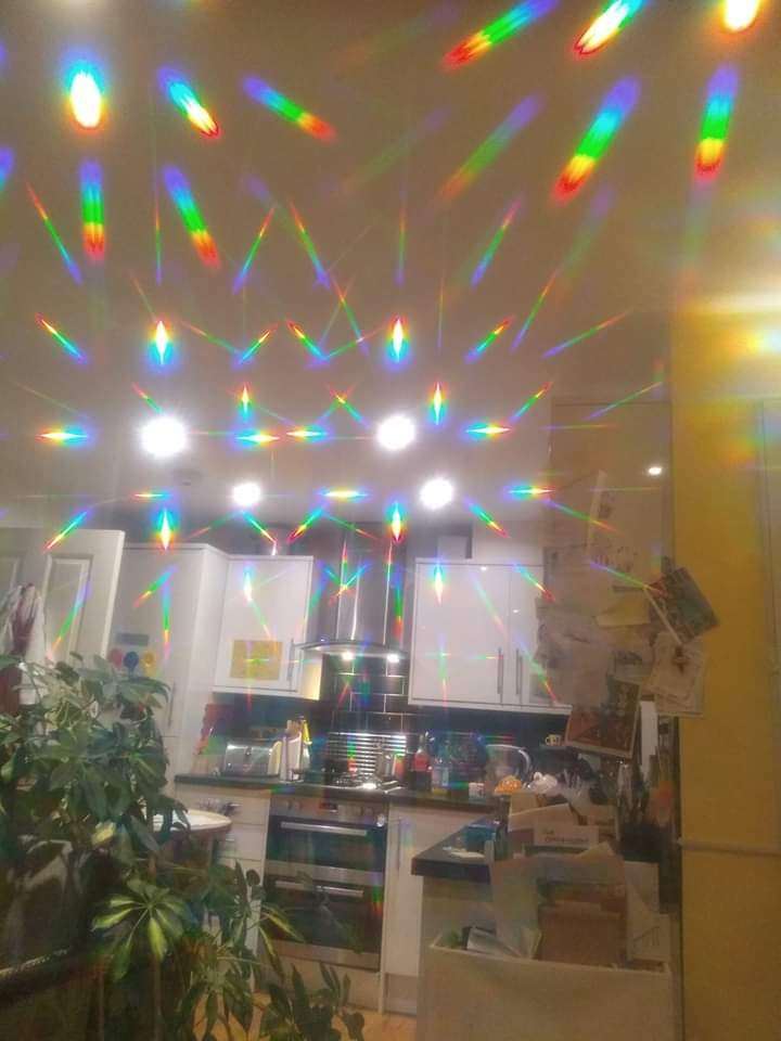 Our kitchen through diffraction glasses - family photo.