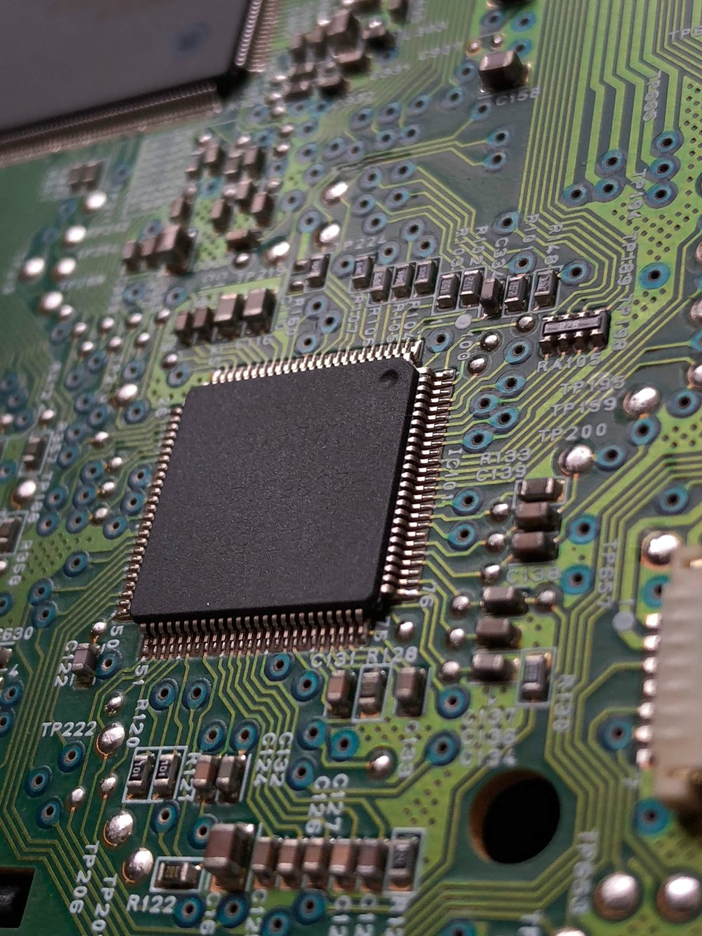 Close-up of a motherboard taken by Aler Kiv from Unsplash