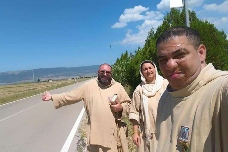 Friar_Juan_Maria_Crisostomo_Right_hitchhiking_with_a_fellow_friar_and_Little_Sister_of_Jesus_and_Mary_Credit_Poor_Friars_[1].jpeg